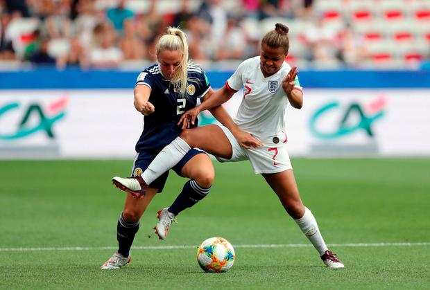 Scotland's Kirsty Smith (left) and England's Nikita Parris battle for the ball. Photo: Richard Sellers/PA Wire