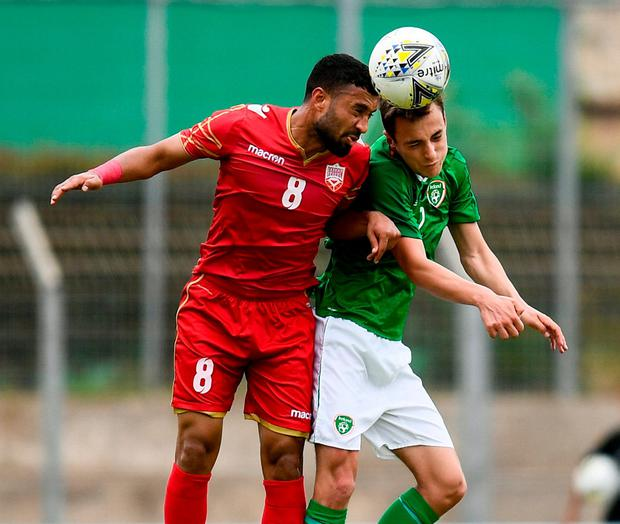 Lee O Connor of Republic of Ireland in action against Mohamed Marhoon of Bahrain. Photo: Alexandre Dimou/Sportsfile
