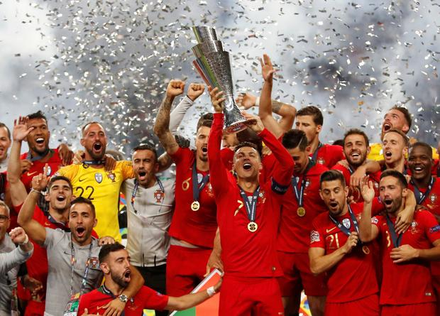 Portugal's Cristiano Ronaldo and team mates celebrate winning the UEFA Nations League Final with the trophy. Action Images via Reuters/Carl Recine