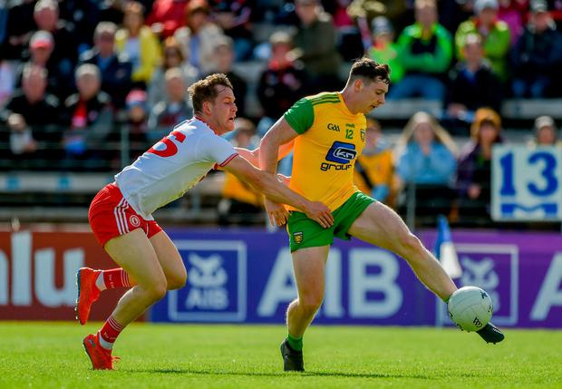 Jamie Brennan of Donegal in action against Kieran McGeary of Tyrone. Photo: Daire Brennan/Sportsfile