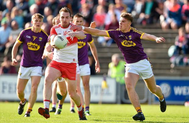 Ryan Bell of Derry in action against Eoin Porter of Wexford. Photo: Matt Browne/Sportsfile