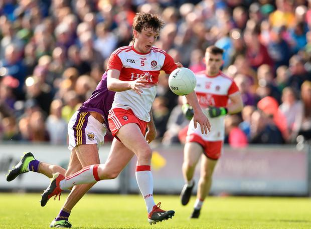 Jason Rocks of Derry in action against Brian Malone of Wexford. Photo: Matt Browne/Sportsfile