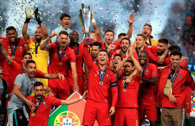 Portugal players celebrate with the trophy. Photo: Mike Egerton/PA Wire