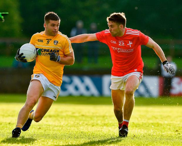 Patrick McBride of Antrim in action against Rohan Holcroft of Louth. Photo: Ray McManus/Sportsfile