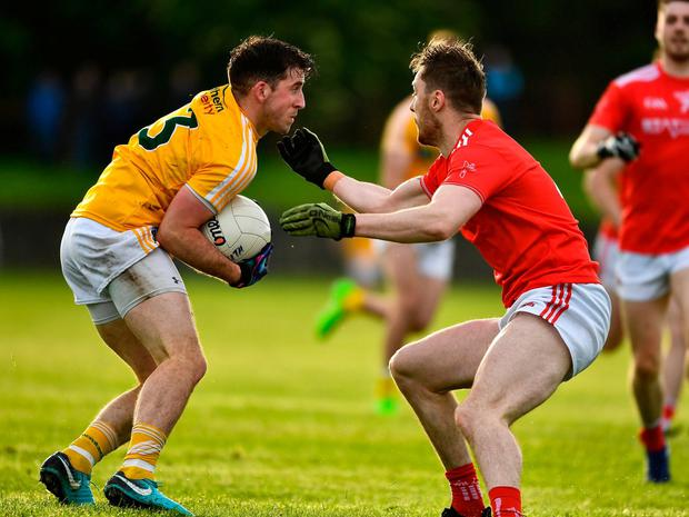 Ryan Murray of Antrim in action against James Craven of Louth. Photo: Ray McManus/Sportsfile