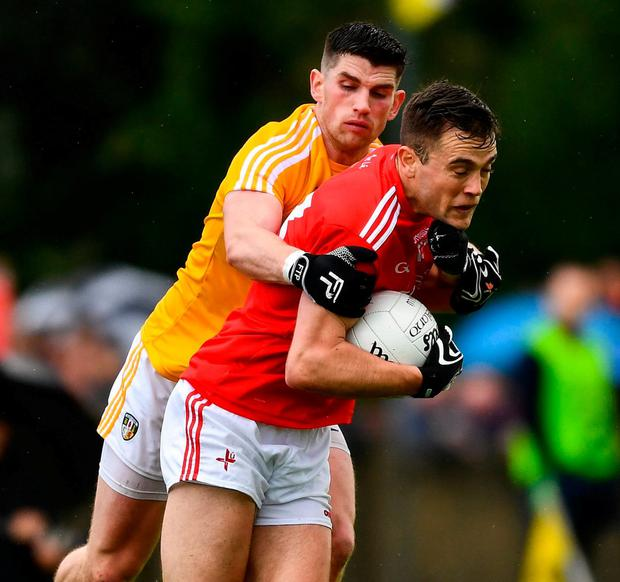Andy McDonnell of Louth in action against Colum Duffin of Antrim. Photo: Ray McManus/Sportsfile