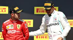 Race winner Lewis Hamilton of Great Britain and Mercedes GP pulls second placed Sebastian Vettel of Germany and Ferrari onto the top step of the podium during the F1 Grand Prix of Canada at Circuit Gilles Villeneuve. (Photo by Mark Thompson/Getty Images)