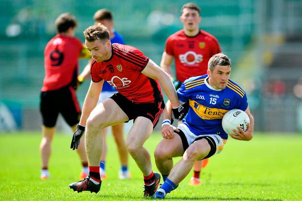 Liam McGrath of Tipperary in action against Brendan McArdle of Down. Photo: David Fitzgerald/Sportsfile
