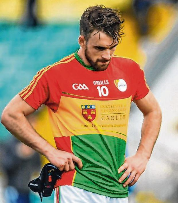 Carlow's Diarmuid Walshe cuts a dejected figure after the final whistle. Photo: Ramsey Cardy/Sportsfile