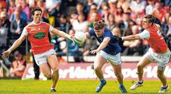 Oisin Pierson of Cavan takes on Armagh's James Morgan (left) and Paul Hughes. Photo: Philip Fitzpatrick/Sportsfile