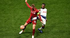 Jordan Henderson of Liverpool battles for possession with Danny Rose of Tottenham Hotspur during the UEFA Champions League Final