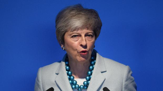 Theresa May wants the BBC to look again at plans not to continue with free TV licences for the over-75s (Leon Neal/PA)