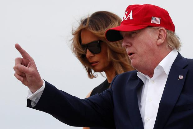 Making his point: US President Donald Trump and his wife Melania. Photo: REUTERS/Carlos Barria