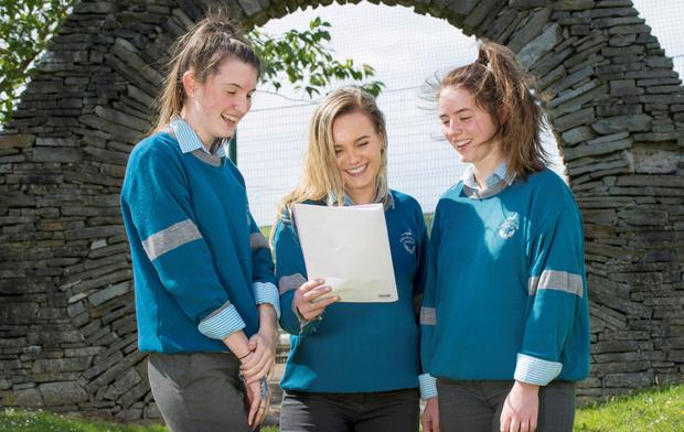 All smiles: Students Alison Duffy, Lauryn Brady and Caoileann Nic A Bhaird review the Leaving Cert Irish Paper 1 at Colaiste Choilm, in Ballincollig, Co Cork. Photo: Daragh Mc Sweeney/Provision