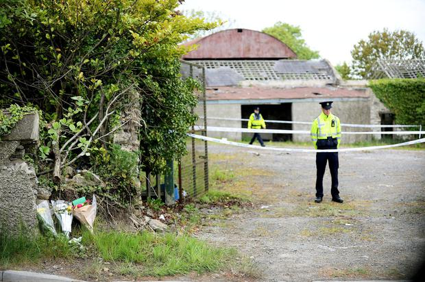 Gardai outside the abandoned property where her body was found. Photo: Caroline Quinn