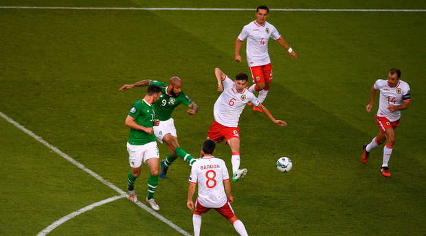 David McGoldrick of Republic of Ireland has a shot on goal which hits the post