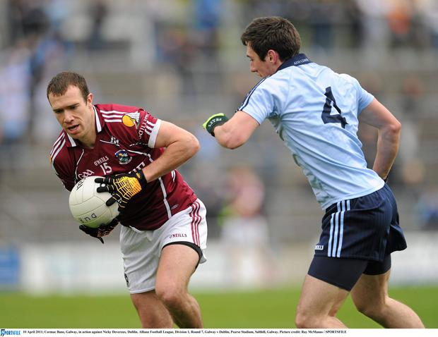 Cormac Bane, Galway, in action against Nicky Devereux, Dublin