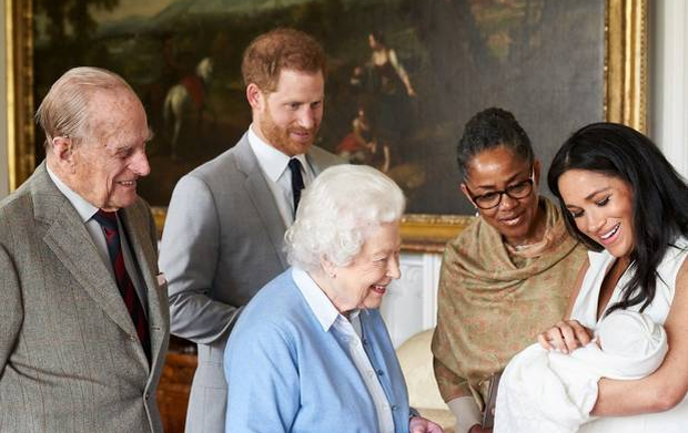 New arrival: Prince Harry and Meghan, Duchess of Sussex are joined by her mother, Doria Ragland, as they show their new son to the queen and the Duke of Edinburgh at Windsor Castle on Wednesday