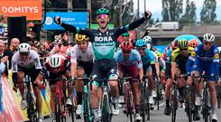 Bora-Hansgrohe rider Ireland's Sam Bennett (front) celebrates as he crosses the finish line after the third stage of the 71st edition of the Criterium du Dauphine cycling race, 177 km between Le Puy-en-Velay and Riom. (Photo by Anne-Christine POUJOULAT / AFP)ANNE-CHRISTINE POUJOULAT/AFP/Getty Images