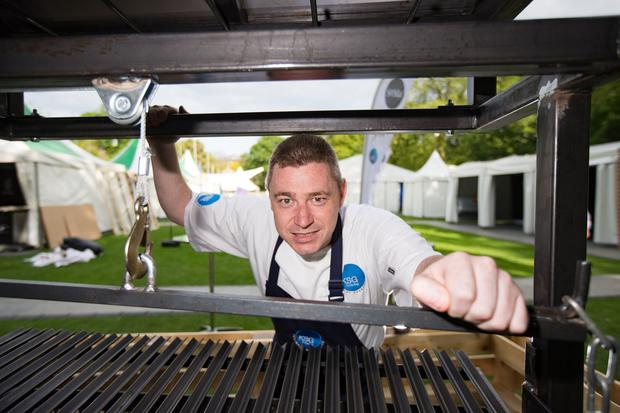 Social food: Chef John Relihan with his barbecue, ahead of the Taste food festival where he will be showing off the best way to cook on a fire pit. Photo: Mark Condren