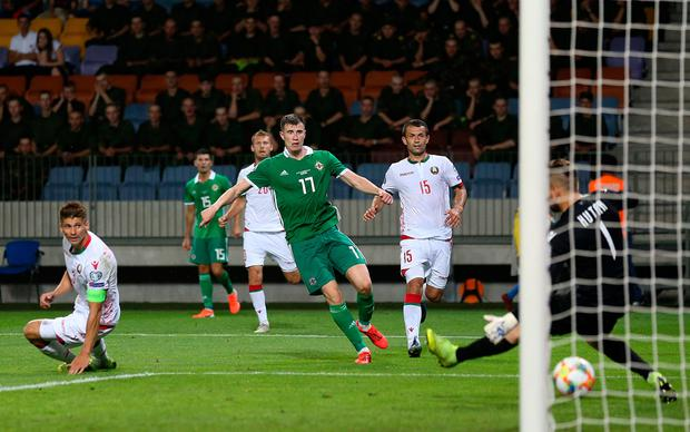 Northern Ireland's Paddy McNair scores his side's winning goal during the UEFA Euro 2020 Qualifying, Group C match at the Borisov Arena. Photo credit: Steven Paston/PA Wire.