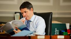 Budget architect: Finance Minister Paschal Donohoe working on Budget 2020 Photo: Gerry Mooney