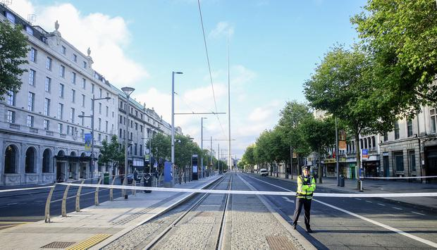 Sealed off: The scene on O'Connell Street during rush hour yesterday following the fatal stabbing. Photo: Gerry Mooney