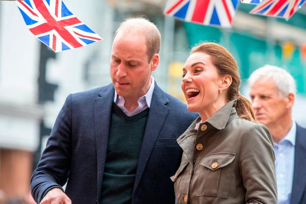 Britain's Prince William, Duke of Cambridge and Britain's Catherine, Duchess of Cambridge inspect local produce during a visit to the market town of Keswick, north west England on June 11, 2019