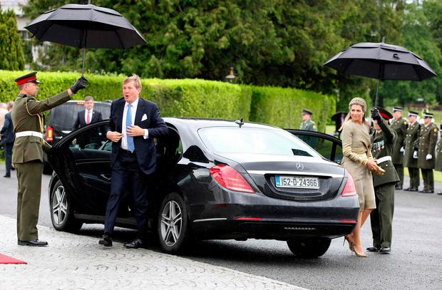 The Netherlands' King Willem-Alexander and Queen Maxima arrive at the Presidential mansion in Pheonix Park in Dublin on June 12, 2019, on the first day of their three-day State Visit to Ireland. (Photo by Paul Faith / AFP)