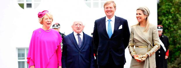 The Netherlands' King Willem-Alexander (CR) and Queen Maxima (R) pose with Ireland's President Michael D Higgins (CL) and his wife Sabina on their arrival at the Presidential mansion in Pheonix Park in Dublin on June 12, 2019, on the first day of their three-day State Visit to Ireland. (Photo by Paul Faith / AFP)