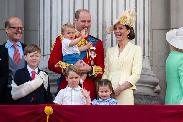 The Duke and Duchess of Cambridge with their children, Prince Louis, Prince George, Princess Charlotte, on the balcony of Buckingham Place watch the flypast after the Trooping the Colour ceremony, as Queen Elizabeth II celebrates her official birthday