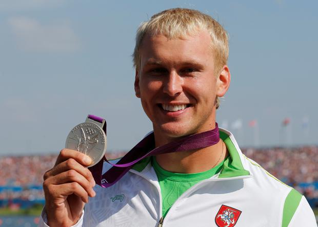 Lithuania's silver medallist Jevgenij Shuklin holds up his medal during the victory ceremony for the men's canoe single (C1) 200m event at Eton Dorney during the London 2012 Olympic Games August 11, 2012. REUTERS/Jim Young/File Photo