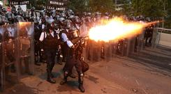 Clashes: Police fire tear gas and rubber bullets at protesters against a proposed extradition bill. Photo: Reuters