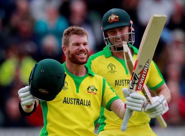 Australia's David Warner celebrates his century. Photo: Reuters/Andrew Couldridge