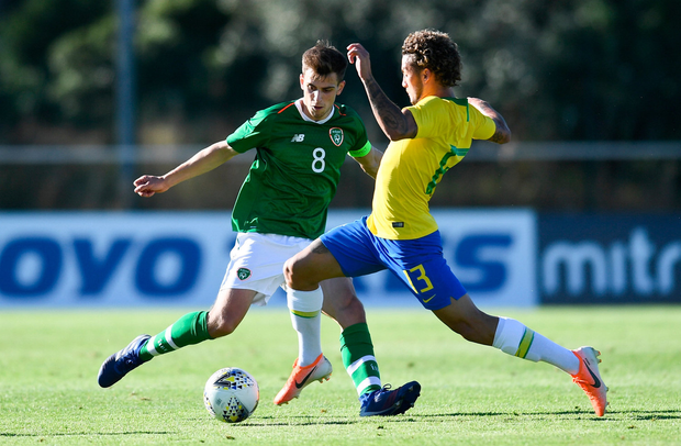 FIRST TOUCH: Jayson Molumby goes for the ball against Claudio Rodrigues in yesterday's semi-final. Pic: Sportsfile
