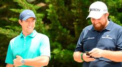 Rory McIlroy laughs with Shane Lowry of Northern Ireland during a practice round prior to the 2019 U.S. Open at Pebble Beach