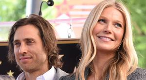 Actor Gwyneth Paltrow (R) and producer Brad Falchuk (L) attend the Hollywood Walk of Fame star unveiling ceremony for producer/director Ryan Murphy, December 4, 2018 in Hollywood, California. (Photo by Robyn Beck / AFP)