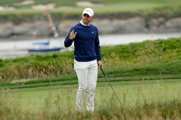 Rory McIlroy, of Northern Ireland, waves after his putt on the 17th hole during the first round of the U.S. Open Championship golf tournament Thursday, June 13, 2019, in Pebble Beach, Calif. (AP Photo/Matt York)