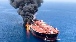 An oil tanker is seen after it was attacked at the Gulf of Oman, June 13, 2019. ISNA/Handout via Reuters