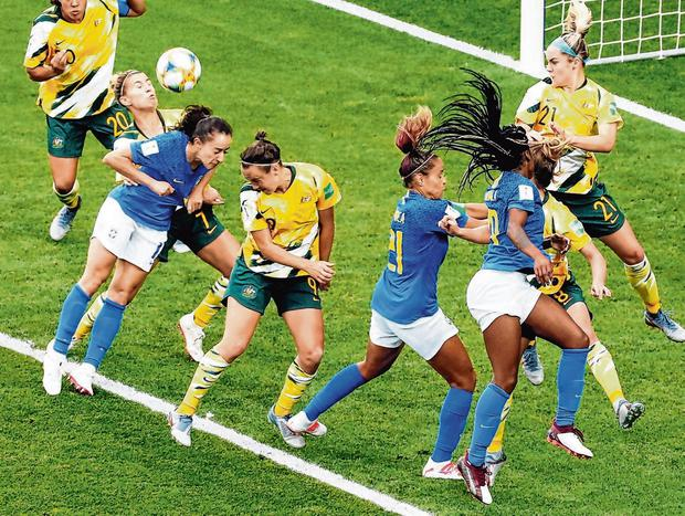 Australia's Steph Catley and Caitlin Foord challenge for the ball during their team's victory against Brazil. Photo: Eric Gaillard/Reuters