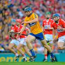 David McInerney gets away from Patrick Horgan during Clare's victory in the 2013 All-Ireland hurling final replay. Photo: Brendan Moran / Sportsfile