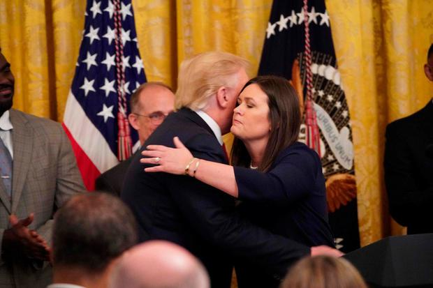 Mr Trump hugs Sarah Sanders in the White House yesterday. Photo: Mandel Ngan/AFP/Getty Images