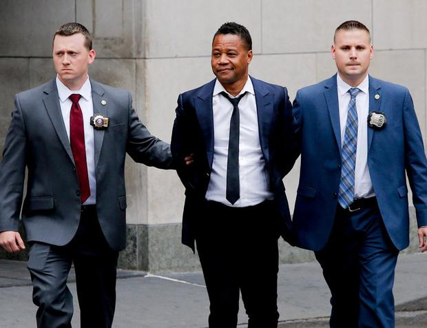 Confident: Actor Cuba Gooding Jr is escorted handcuffed by officers as he exits the NYPD Special Victims Unit in Harlem. Photo: Eduardo Munoz/Reuters