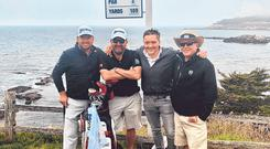 Re-united: Graeme McDowell with caddie Ken Comboy, his former agent Conor Ridge and his father Kenny on the seventh tee at Pebble Beach earlier this week