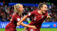 Jodie Taylor of England celebrates scoring the winning goal with Beth Mead during the 2019 FIFA Women's World Cup France group D match between England and Argentina at on June 14, 2019 in Le Havre, France. (Photo by Marc Atkins/Getty Images)