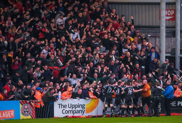 Bohemians players and fans celebrate after Daniel Mandroiu's winning goal. Photo: Sportsfile