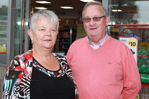 Huge hike: Martin Mulligan with his wife at his service station in Athlone. Photo: Kevin McNulty
