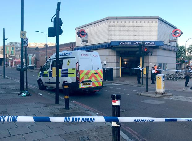 A police cordon on Bedford Road in Clapham, where three men were found suffering stab and slash injuries in the early hours of Saturday Photo credit: Emma Bowden/PA Wire