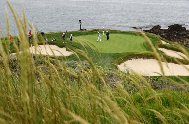 June 14, 2019; Pebble Beach, CA, USA; A general view of Rory McIlroy , Jon Rahm and Marc Leishman on the 7th green during the second round of the 2019 U.S. Open golf tournament at Pebble Beach Golf Links. Mandatory Credit: Rob Schumacher-USA TODAY Sports