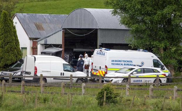 Forensics at scene where woman's body found in Co. Mayo. Photo: Mark Condren